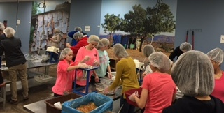 Confirmation Students Help at Feed My Starving Children Intro Photo